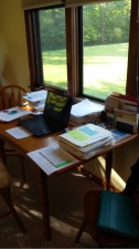 Cathy's writing table in a little cottage by a pond